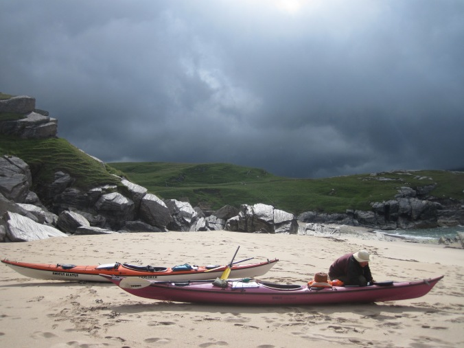 Charlotte Gannet emptying the kayaks before the storm